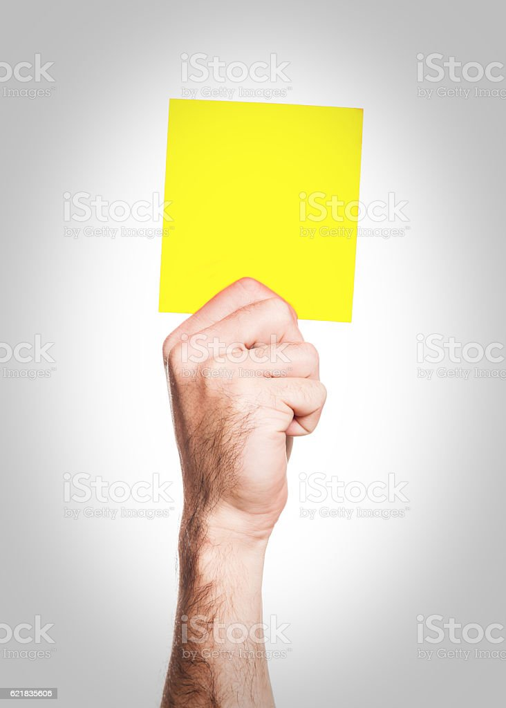 Yellow card isolated on a white background stock photo