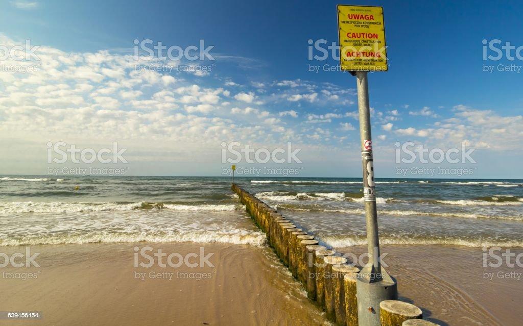 Yellow caution sign, Baltic Sea – zdjęcie
