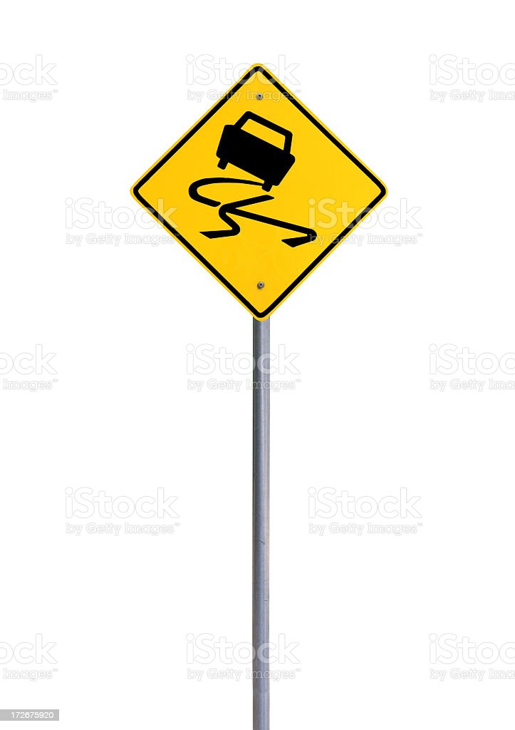 Yellow caution sign warning people of slippery roads royalty-free stock photo