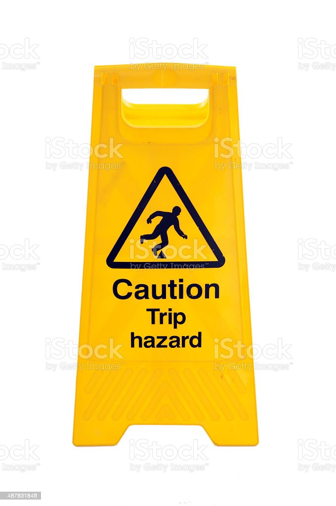 Yellow Caution slippery wet floor sign isolated on white background stock photo