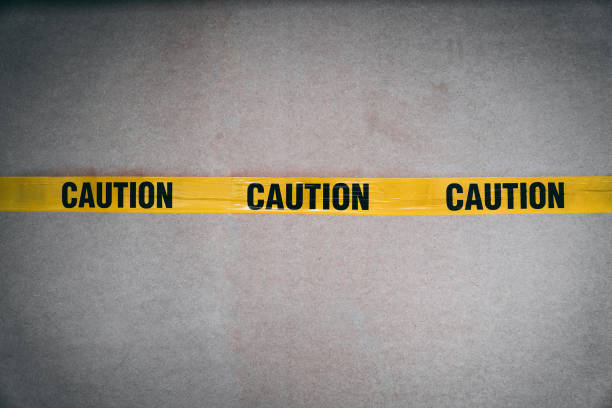 yellow caution tape barring entrance with added grain - adhesive tape stock photos and pictures