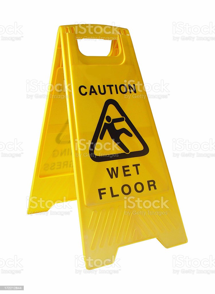 Yellow caution wet floor sign on a white backdrop stock photo