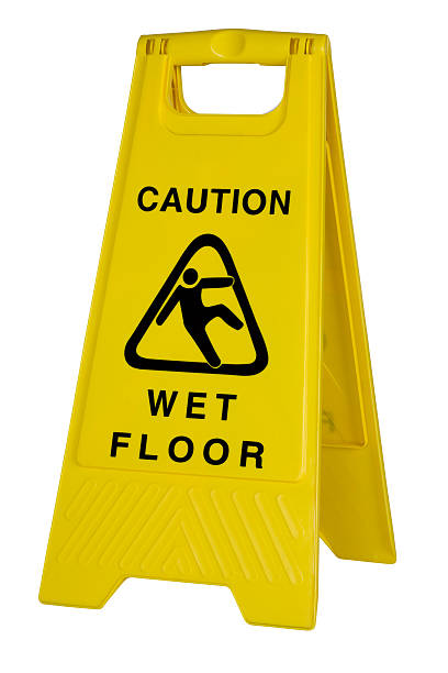 yellow caution wet floor sign on white background - wet stock pictures, royalty-free photos & images