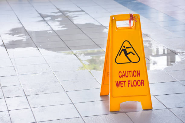 Yellow Caution Wet Floor Sign Wet floor caution sign falling stock pictures, royalty-free photos & images
