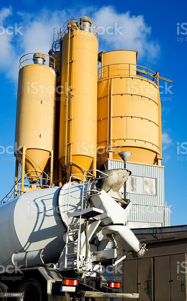 Yellow cement silos and concrete mixer royalty-free stock photo