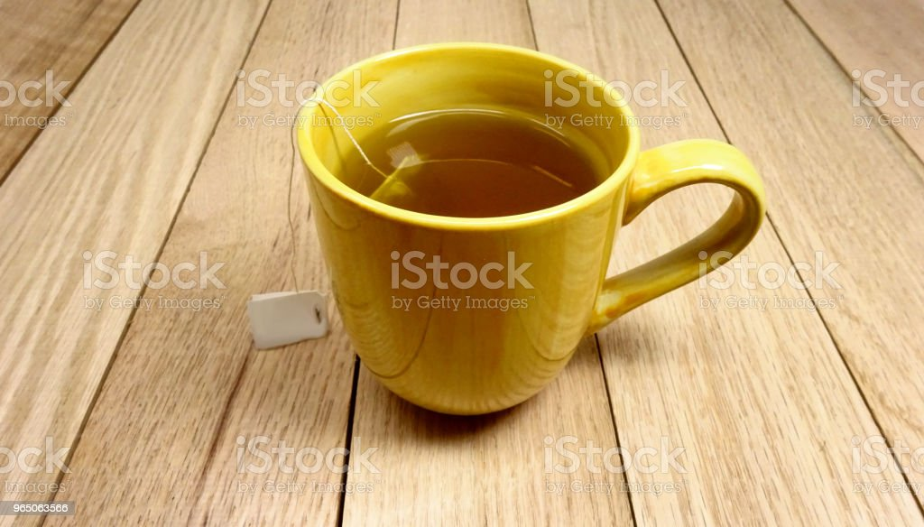 Yellow Ceramic Mug of Organic Tea. Photo image zbiór zdjęć royalty-free