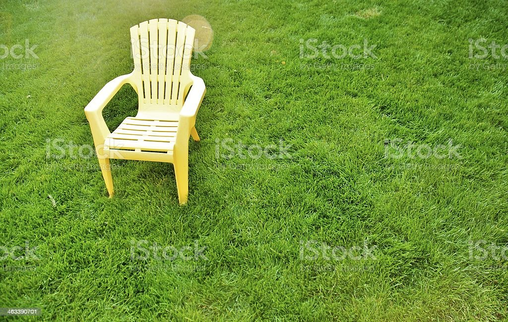 Yellow chair on the lawn stock photo