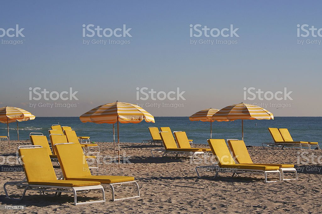 Yellow chairs and umbrellas at South Beach royalty-free stock photo