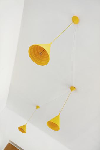 Yellow Chandeliers On Ceiling - zdjęcia stockowe i więcej obrazów Bez ludzi