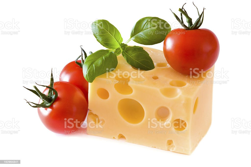 Yellow cheese with tomatoes royalty-free stock photo