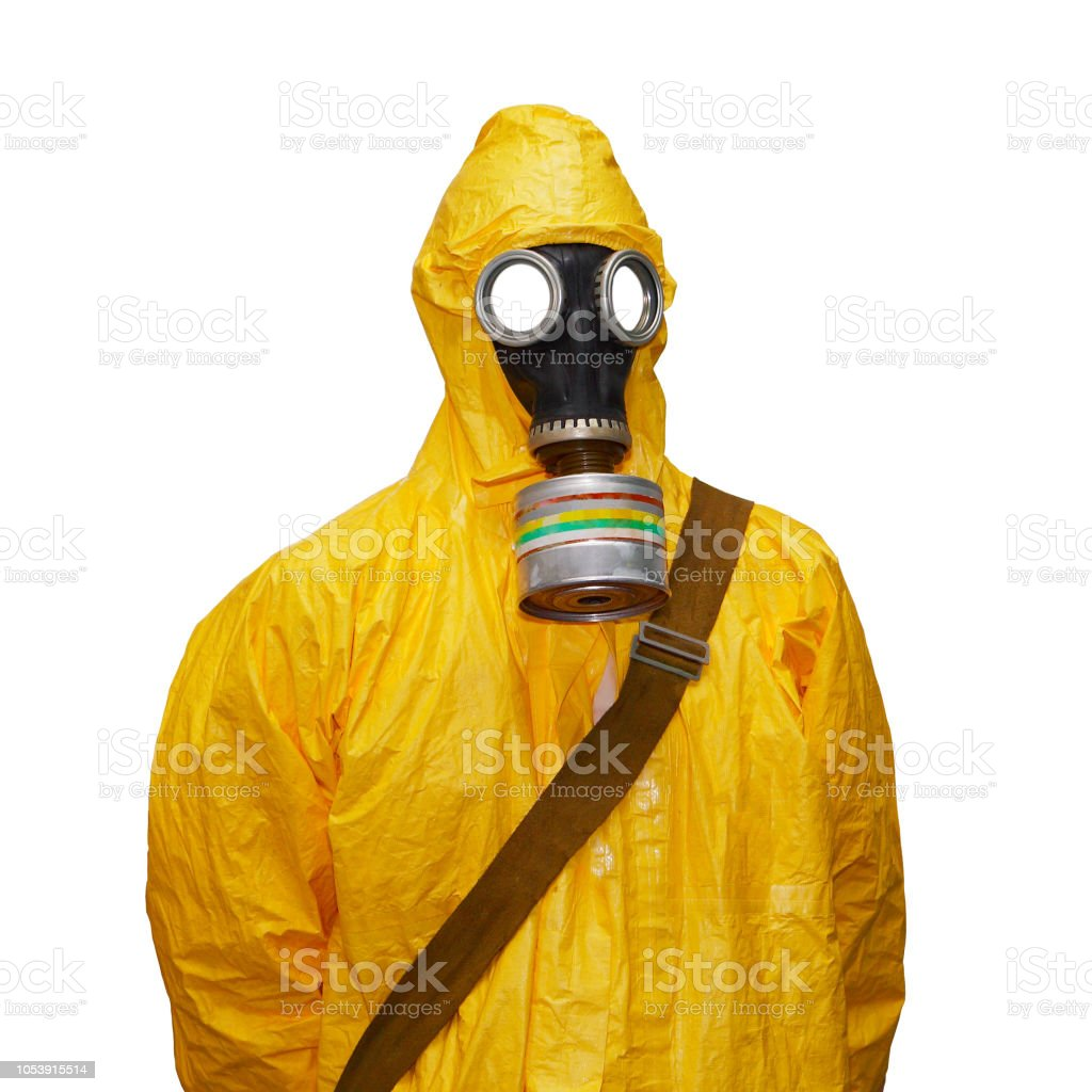 Yellow chemical protective suit with gas mask, isolated on white...