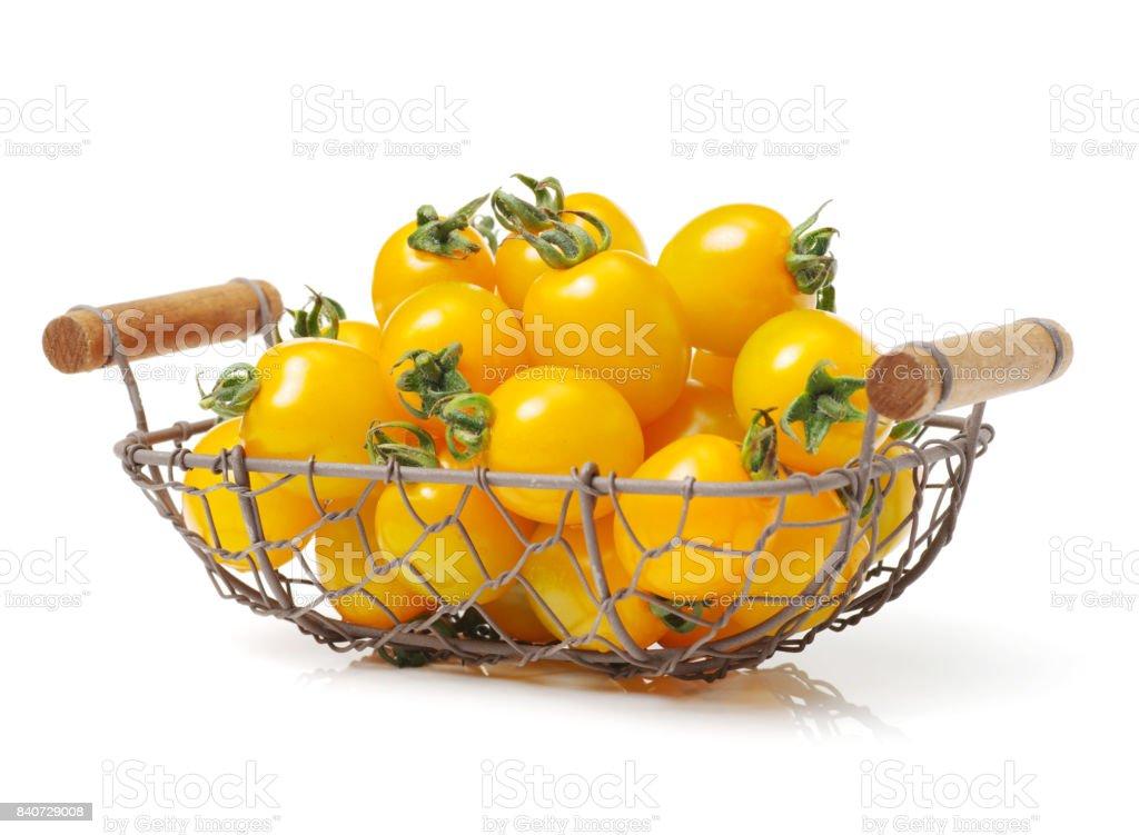 Yellow Cherry Tomatoes on white background stock photo