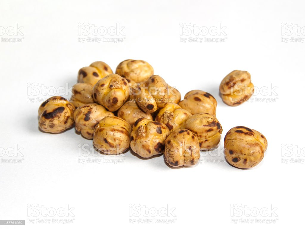 yellow chickpeas on white background stock photo