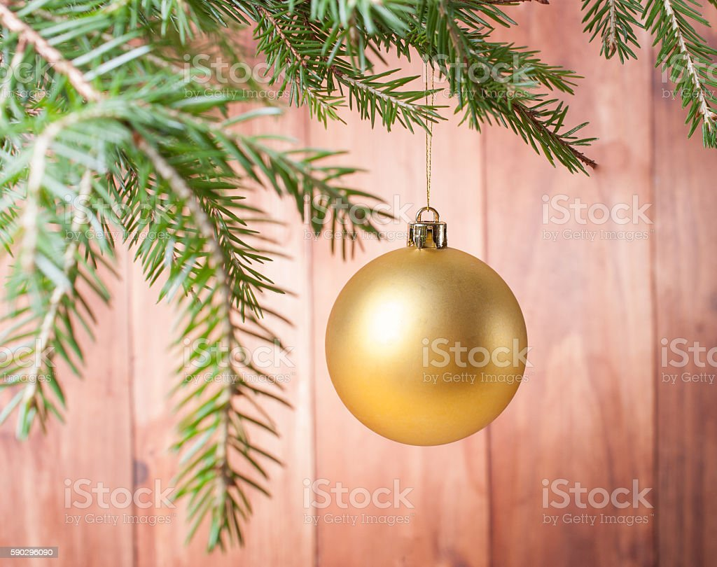 Yellow Christmas ball on branch Стоковые фото Стоковая фотография