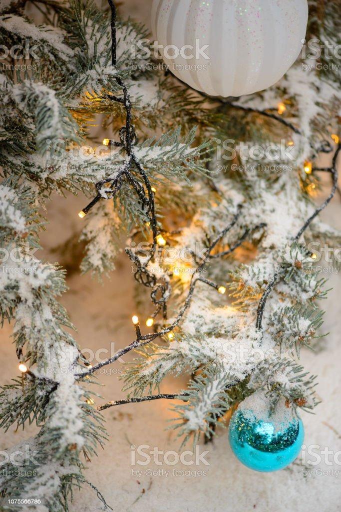 Yellow Christmas Lights On Snowy Xmas Tree Stock Photo Download Image Now Istock