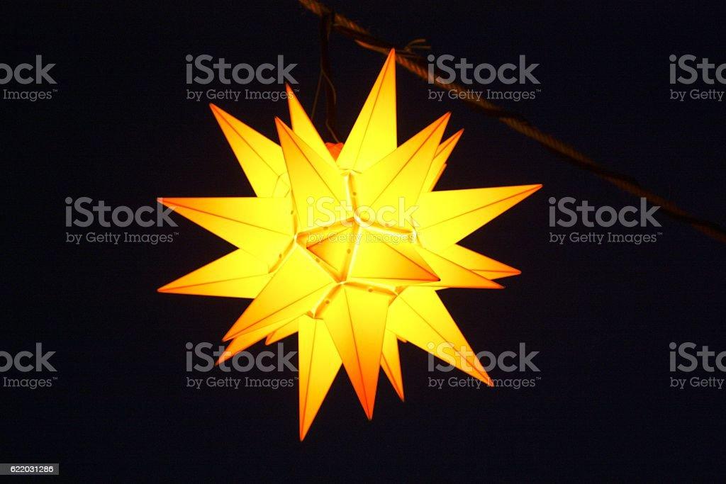 Yellow Christmas star at night stock photo