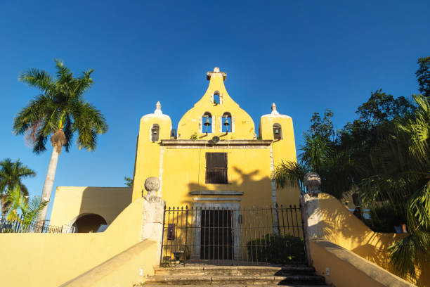 Yellow church with bell tower 'Santa Isabel' in Merida, Yucatan, Mexico stock photo