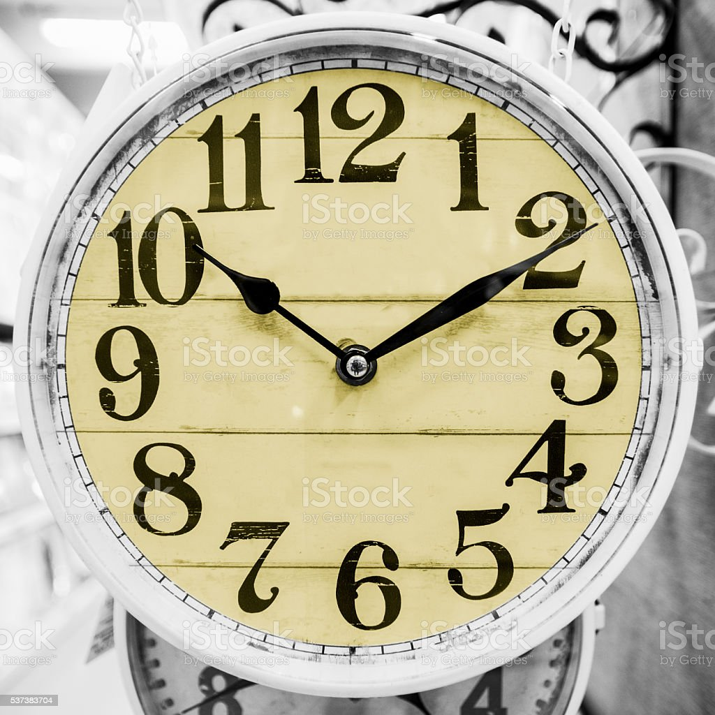 Yellow clock in a classical style. stock photo