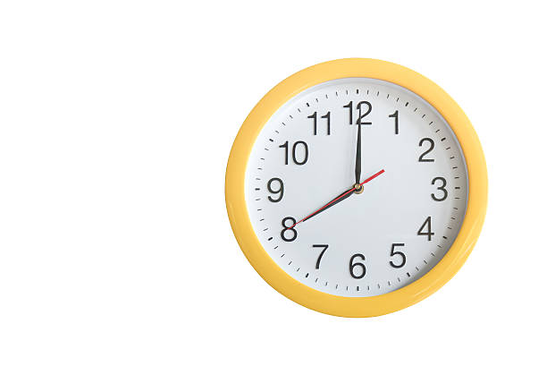 Yellow clock isolated on white background. Clipping path - foto de stock