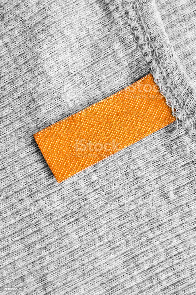 Yellow clothes label stock photo