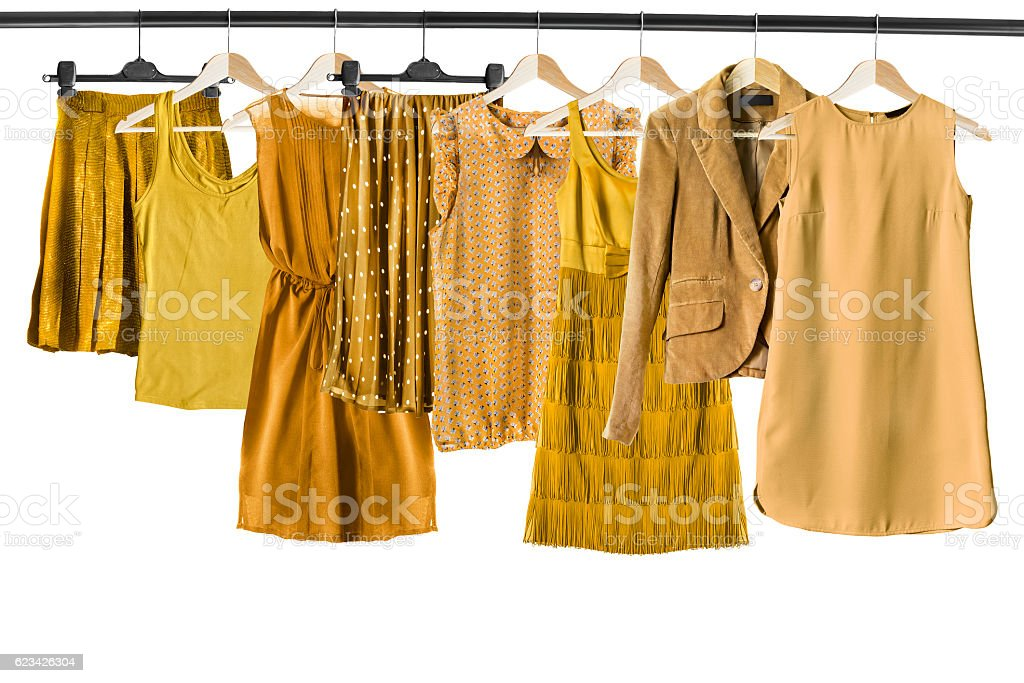 Yellow clothes on clothes racks