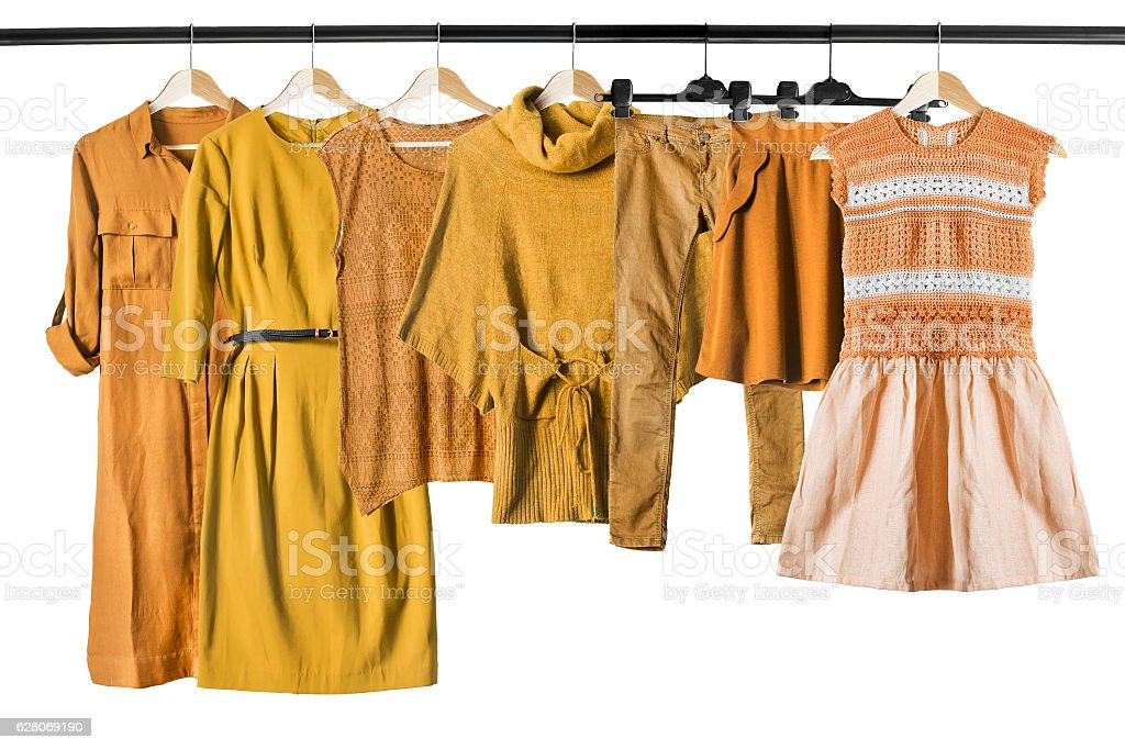 Yellow clothes on clothes racks stock photo