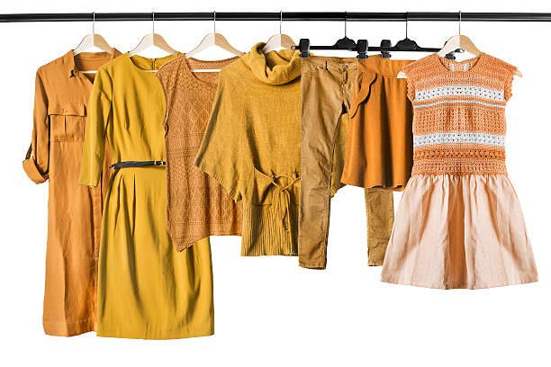 Yellow clothes on clothes racks - foto de stock