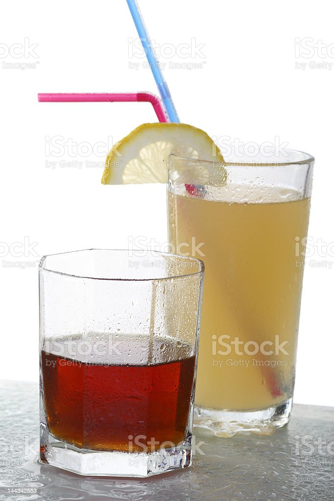 yellow cocktail and a glass with whisky royalty-free stock photo
