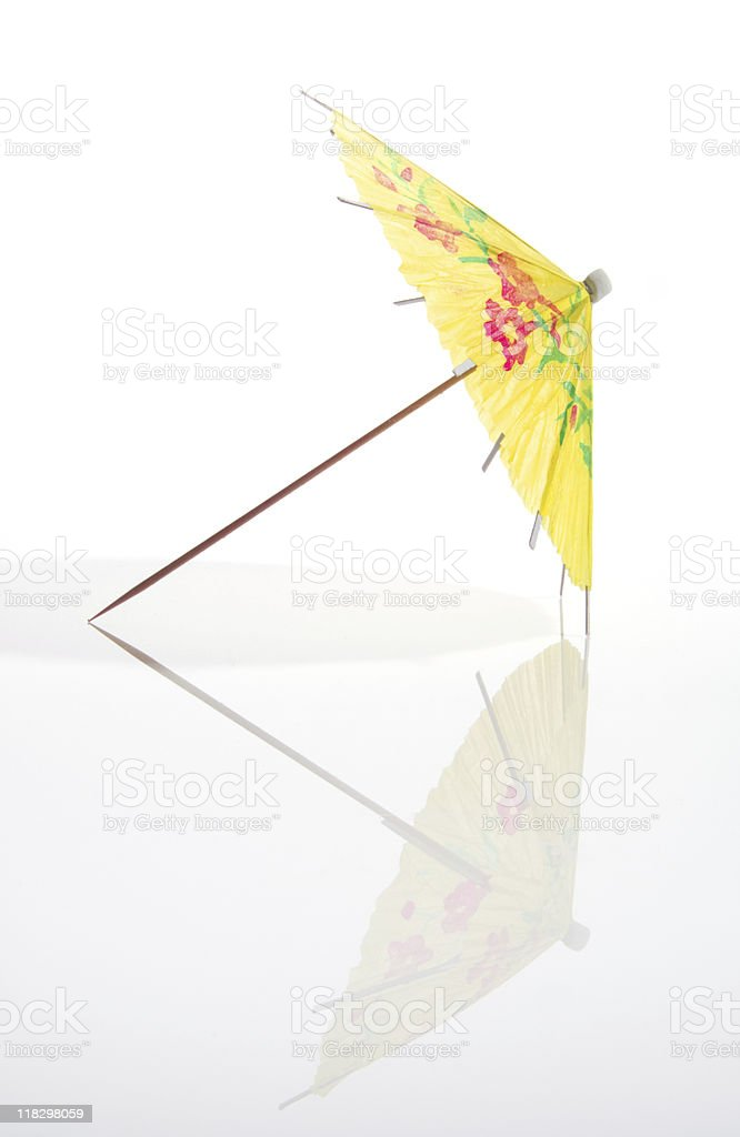 Yellow Cocktail Umbrella With Full Reflection stock photo