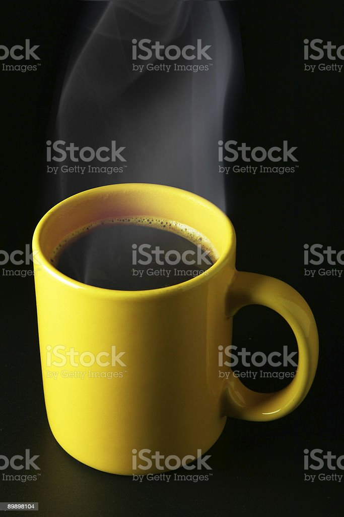 Yellow coffee cup with steam royalty-free stock photo