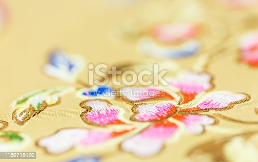 532522827istockphoto yellow color Chinese traditional style silk detail macro view 1156718120