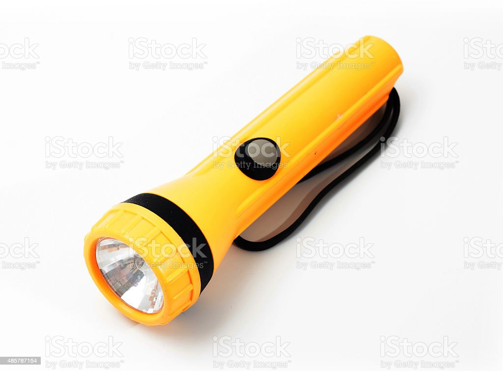 Yellow color flashlight on white background stock photo