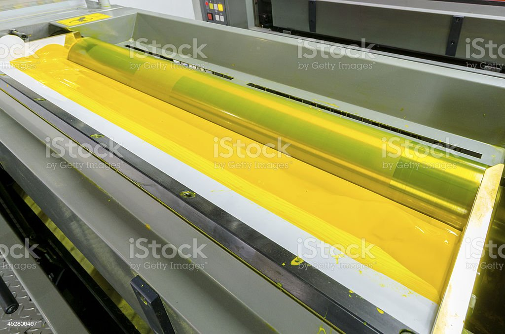 yellow color ink down at offset printed machine roller royalty-free stock photo