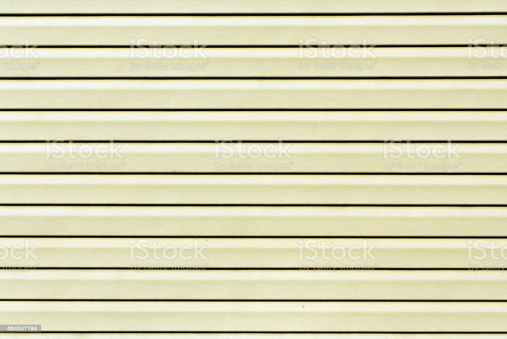 Modèle de mur en plastique de couleur jaune. - Photo