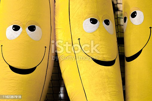 yellow color smile face banana toy display