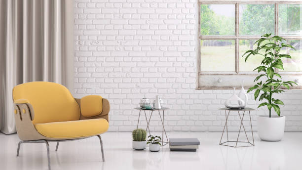 Yellow colored armchair with coffee table, flowers and blank wall template stock photo