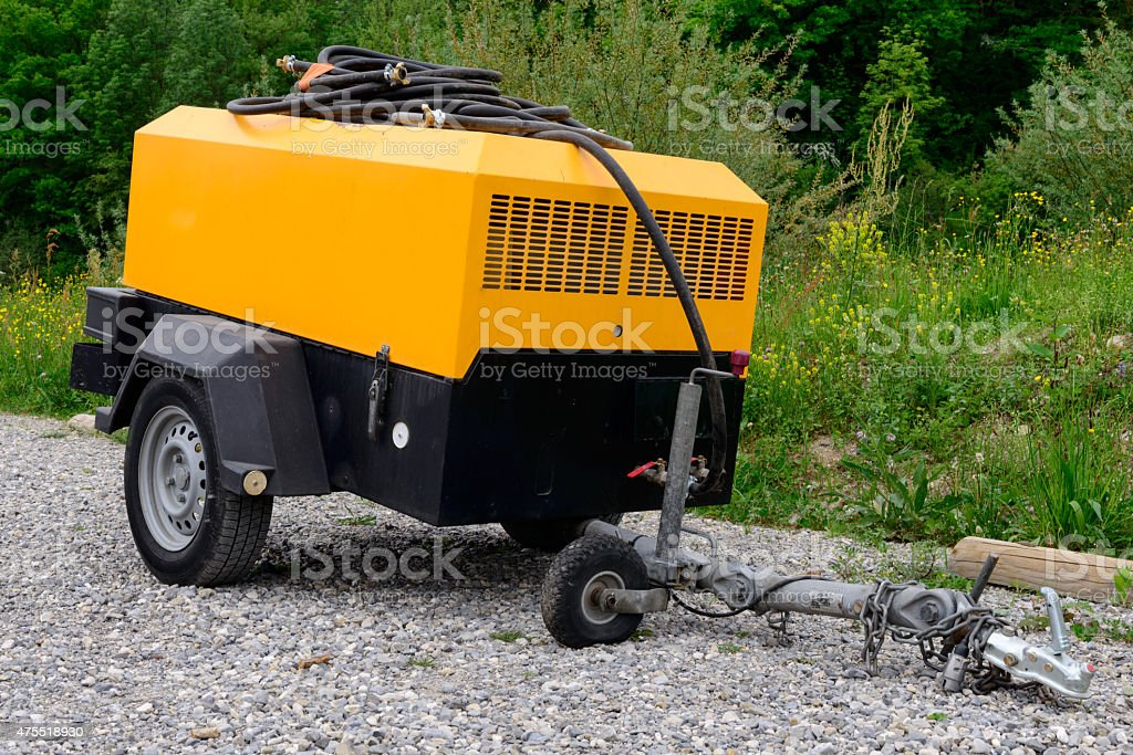 yellow compressor site stock photo