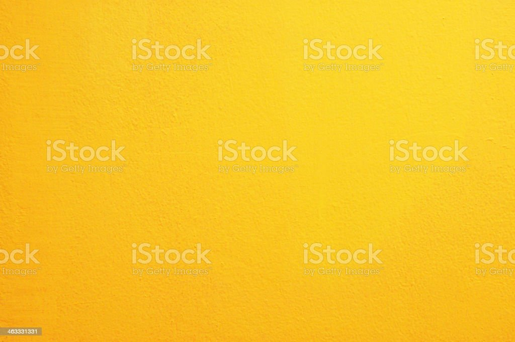 Yellow concrete wall background stock photo