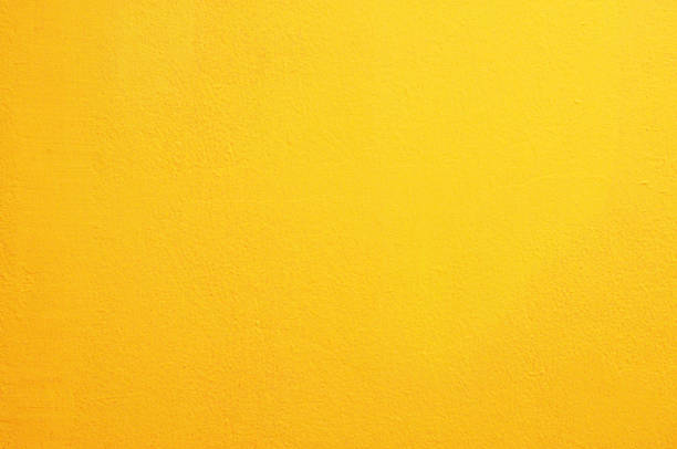 yellow concrete wall background - solid stock photos and pictures