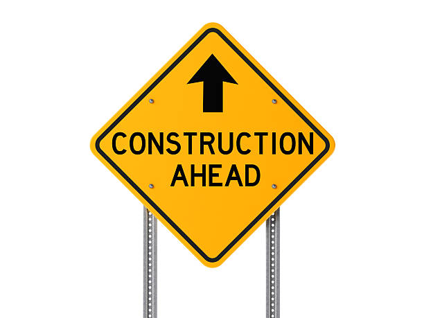 Yellow Construction Ahead Sign Isolated On White Background stock photo