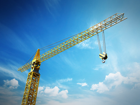 Yellow construction frame against blue sky background