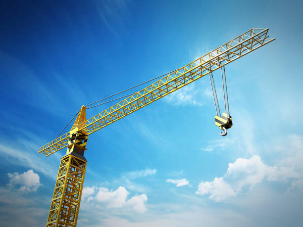 Yellow construction frame against blue sky background stock photo