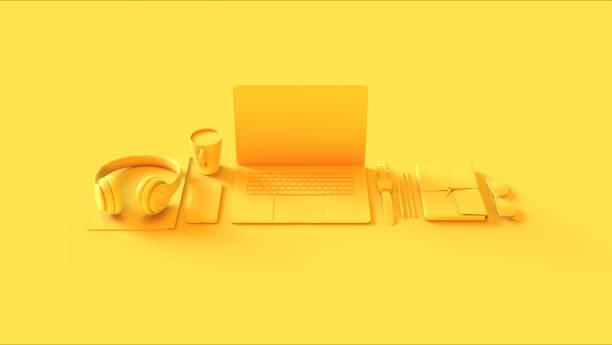 黃色當代熱桌面辦公室設置與筆記本電腦手機耳機記事本太陽鏡 - 虛擬辦公室 個照片及圖片檔