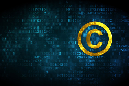 A Yellow Copyright Symbol On A Digital Background Stock Photo - Download Image Now