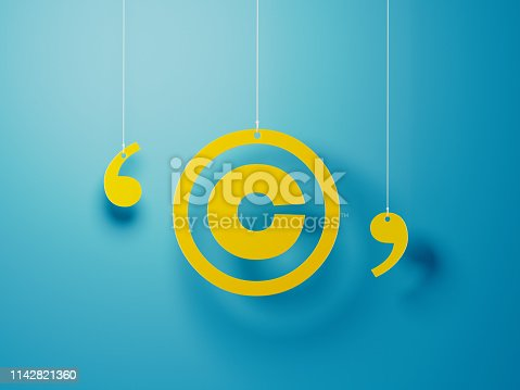 Yellow copyright symbol with string hanging over blue background. Horizontal composition with copy space.