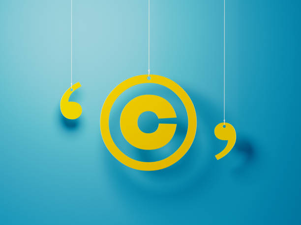 Yellow Copyright Symbol With String Over Blue Background Yellow copyright symbol with string hanging over blue background. Horizontal composition with copy space. intellectual property stock pictures, royalty-free photos & images