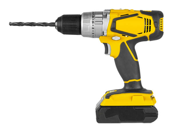 Yellow cordless electronic screwdriver drill hand tool isolated white backgroun. DIY industry construction hobby concept Yellow cordless electronic screwdriver drill hand tool isolated on white backgroun. DIY industry construction hobby concept drill stock pictures, royalty-free photos & images