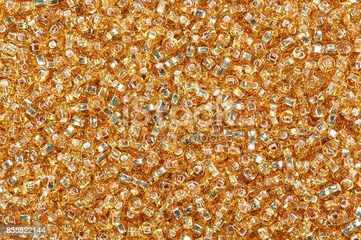 istock Yellow corn seed beads background 835822144