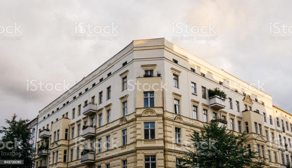 yellow corner building in berlin stock photo