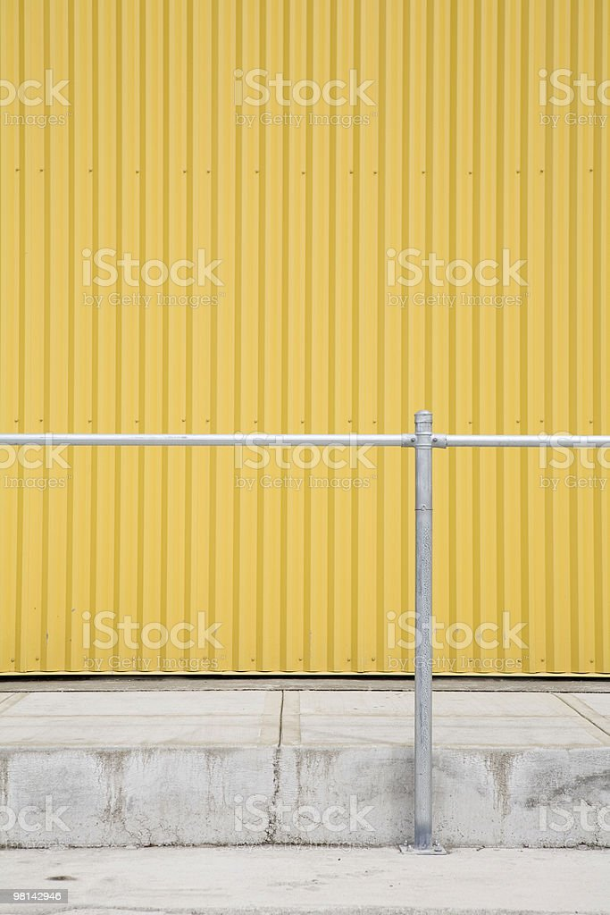 yellow corrugated metal wall and railing royalty-free stock photo